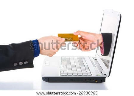 A hand comes out from laptop's screen is receiving payment using credit card.