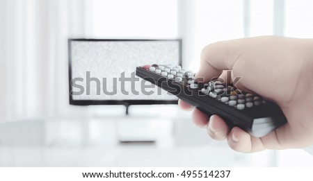 a hand control tv channel in the living room