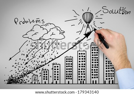 A hand drawing a successful strategy - stock photo