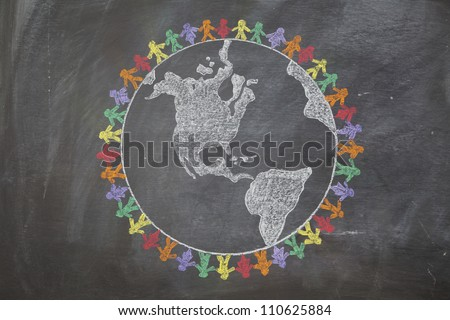 A hand drawn chalkboard shows multi-ratial people holding hands around the world to show care for the earth, peace, and unity - stock photo