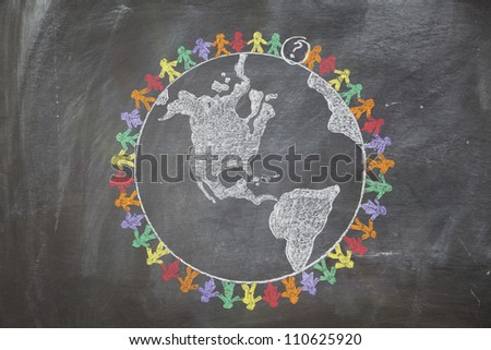 A hand drawn chalkboard shows multi-ratial people holding hands around the world with one person missing to create the last link in the chain. - stock photo