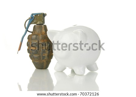 A hand grenade next to a piggy bank indicating financial risk or bankruptcy