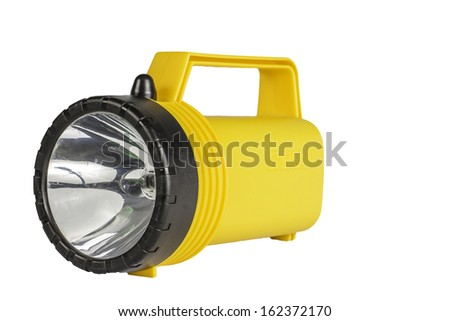 A hand held flashlight isolated on a white background. - stock photo