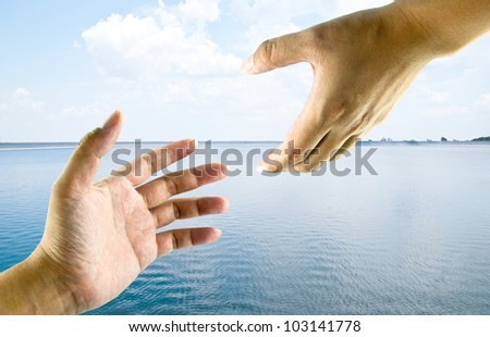 A hand help from another hand. This image ideas for a rescue, safety, religious or support concept. - stock photo