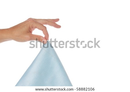 A Hand Holding a Blue Cleaning Cloth by the Fingers - stock photo