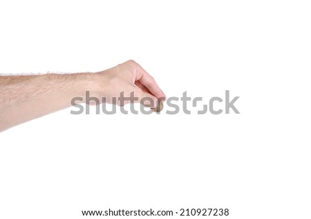 A hand holding a coin on white background - stock photo