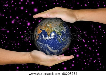 A hand holding a globe, saving environment recycle - stock photo