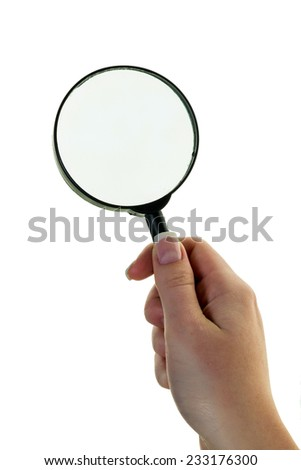 a hand holding a magnifying glass. viewed through the magnifying glass. - stock photo