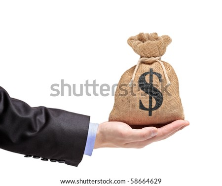 A hand holding a money bag isolated on white background