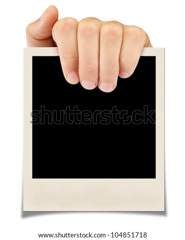 A hand holding a photograph. isolated on a white background - stock photo