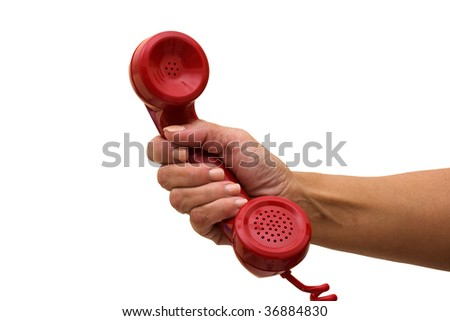 A hand holding a red handset of a telephone, answering the telephone