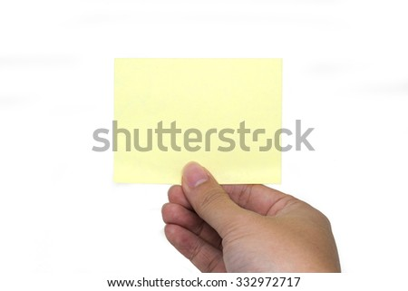 A hand holding a sticky note in isolated background
