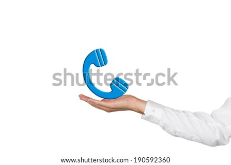 A hand holding a 'telephone' icon - stock photo