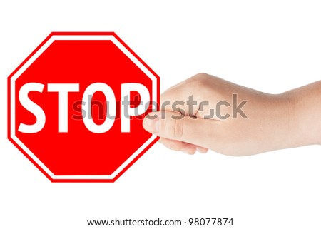 A hand holding a traffic sign stop on the white background - stock photo