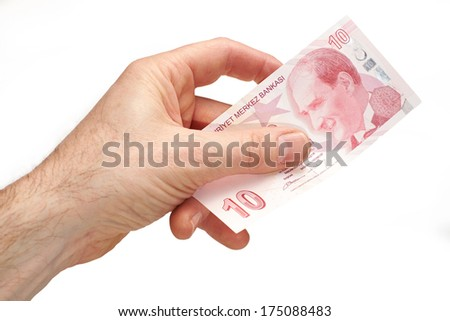 A hand holding a Turkish 10 Lira note, on a white background.