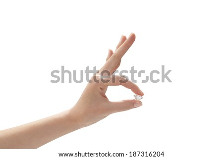 A hand holding an diamond, isolated on white background - stock photo