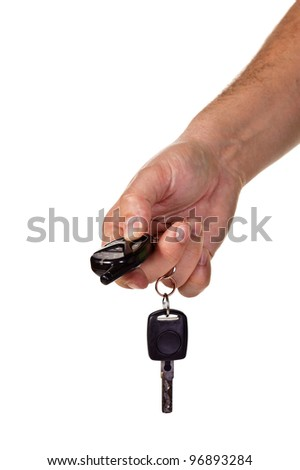 A hand holding car keys and a remote control for keyless entry. Isolated over white - stock photo