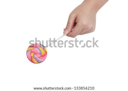 a hand holding lollipop - stock photo