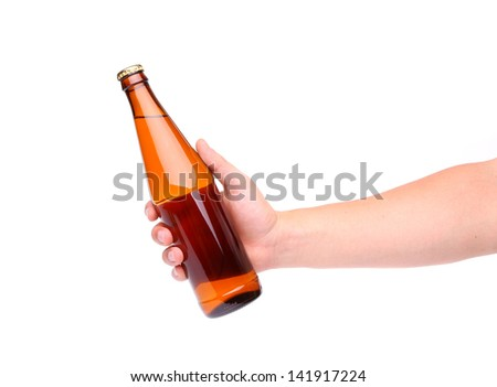 A hand holding up a yellow beer bottle without label over a white background vertical format - stock photo