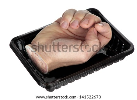 A hand in a tray could be offered to cannibals, or used to showcase punishment for stealing. - stock photo