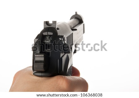 A hand is holding a gun - stock photo