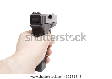 a hand is holding a handgun, isolated on white background