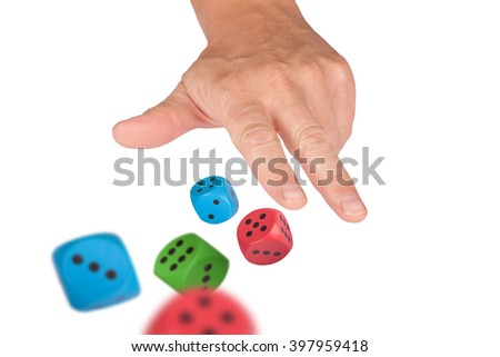 A hand isolated on white is throwing some dice
