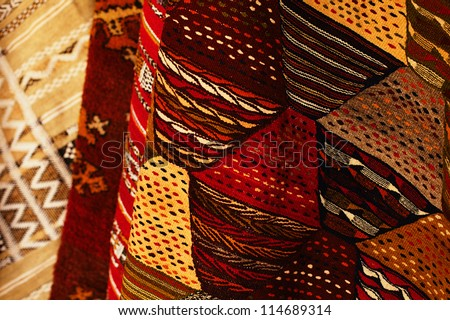 a hand made carpets background in souk,  Marrakesh, Morocco - stock photo