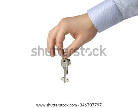 A hand of a businessman keep up a house key isolated on a white background