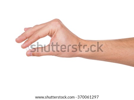 A hand of a man hold two pills between thumb and forefinger isolated on a white background