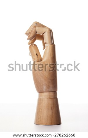 A hand of wood doll make blow(fist, punch) isolated white background at the studio. - stock photo