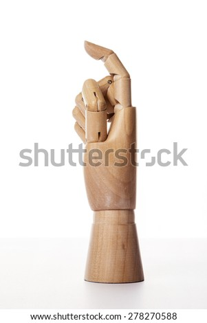 A hand of wood doll make index finger(forefinger) direction, one(1) isolated white background at the studio. - stock photo