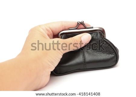 A hand on a purse  - stock photo