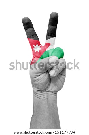A hand painted with a Jordan flag making a V for victory symbol, isolated against white.  - stock photo