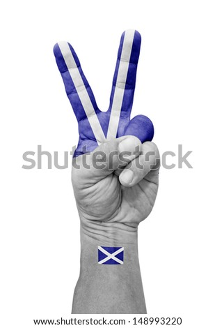 A hand painted with a Scotland flag making a V for victory symbol, isolated against white.  - stock photo