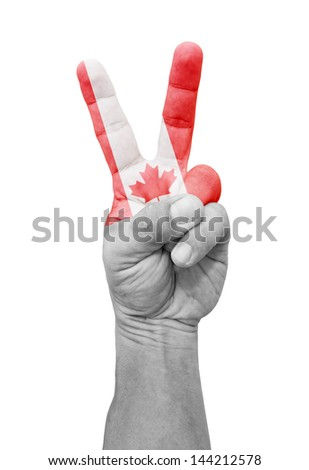 A hand painted with Canada flag making a V for victory symbol, isolated against white.  - stock photo
