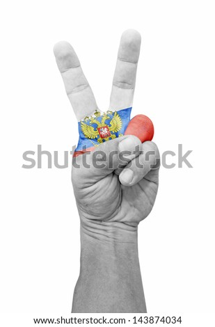 A hand painted with Russia flag making a V for victory symbol, isolated against white.  - stock photo