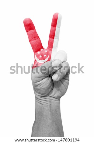 A hand painted with Singapore flag making a V for victory symbol, isolated against white.  - stock photo