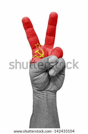 A hand painted with Soviet Union flag making a V for victory symbol, isolated against white. - stock photo