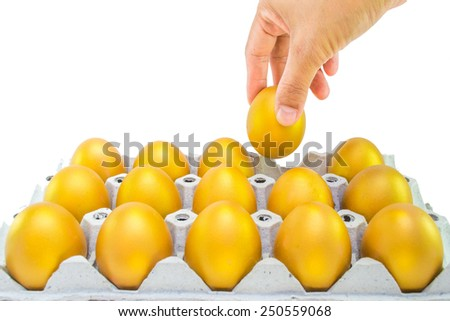 A hand picking a golden egg opportunity: concept of fortune and a chance to get rich in investment and life  - stock photo