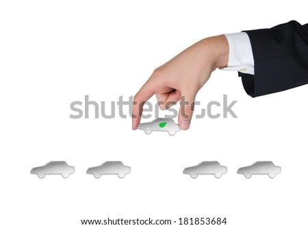 A hand picks up a car 2 - stock photo