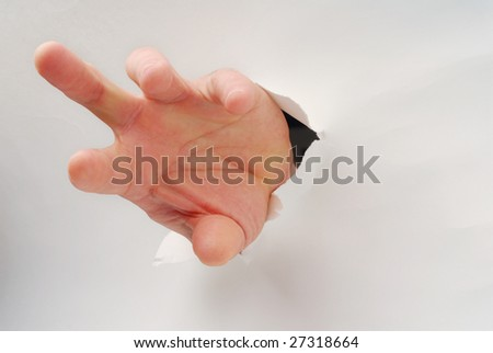A hand popping through a paper