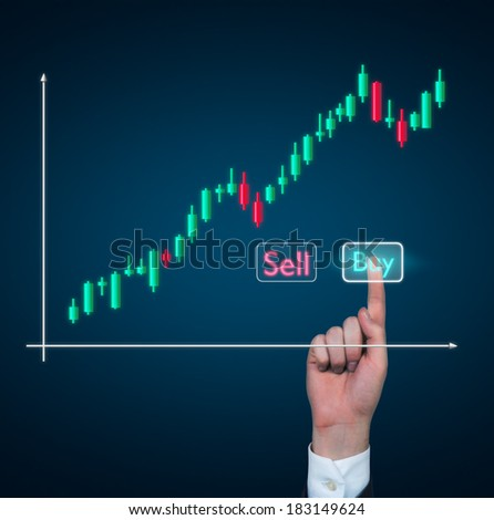 A hand pushing to the 'buy' button. stock exchange quotations. - stock photo