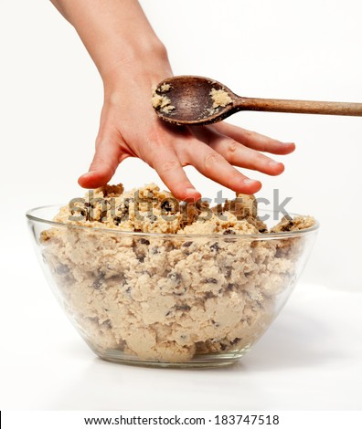 A hand reaching for cookie dough and getting caught - stock photo