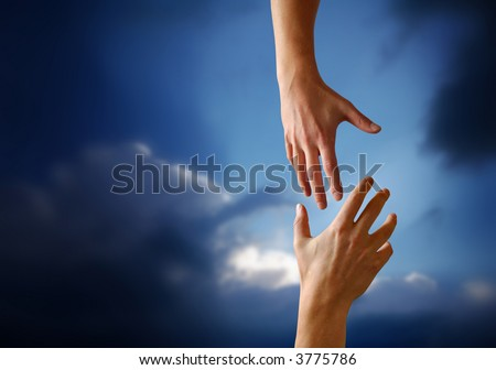 A Hand reaching Out to Someone - stock photo