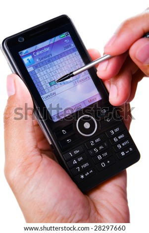 A hand using stylus on touch screen of a PDA phone. - stock photo