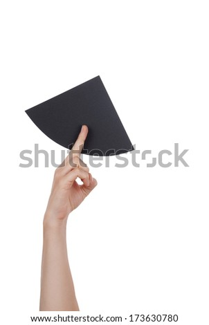 A Hand With a Black Piece of Paper, Isolated