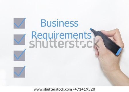 A hand with a marker writing 'Business Requirements'.