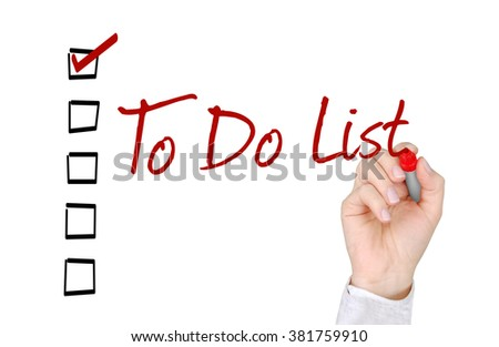 A hand with a marker writing 'To Do List'. - stock photo