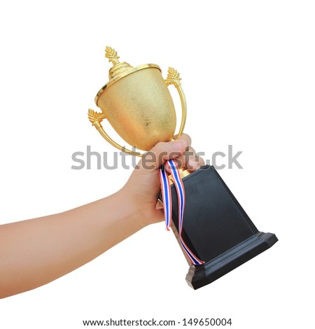 a hand with gold cup winner - stock photo